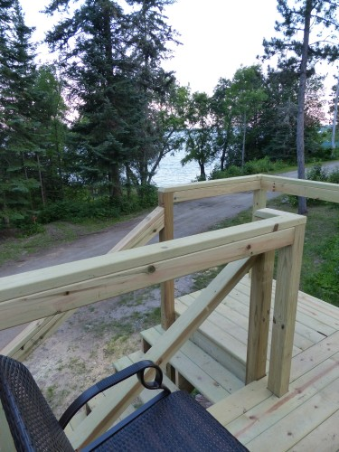 Deck with glider overlooks White Iron Lake.
