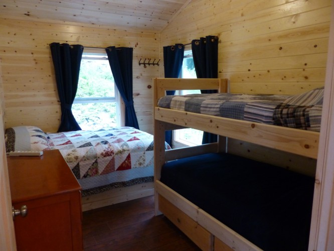 Second bedroom with full bed and twin bunk bed.